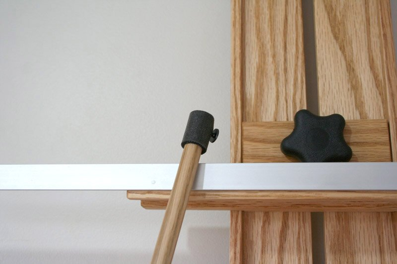 Tueller Wall Easel with hanging mahl stick attachment - closeup view