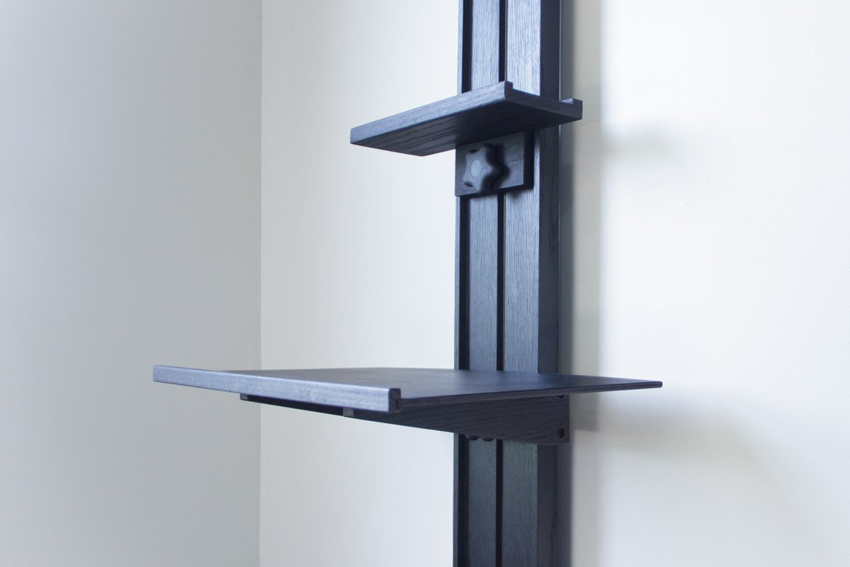 Closeup image of a Tueller Wall Easel with ebonized oak finish